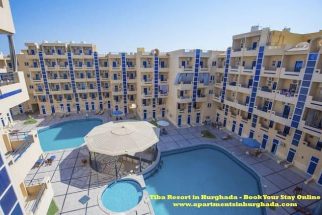 Book Our Award-Winning Holiday Rentals at Tiba Resort in Hurghada Online - Modern Facilities - Swimming Pools - Store - Book on www.apartmentsinhurghada.com -